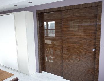 Double Pocket Door Transforms Living Room Into A Bedroom
